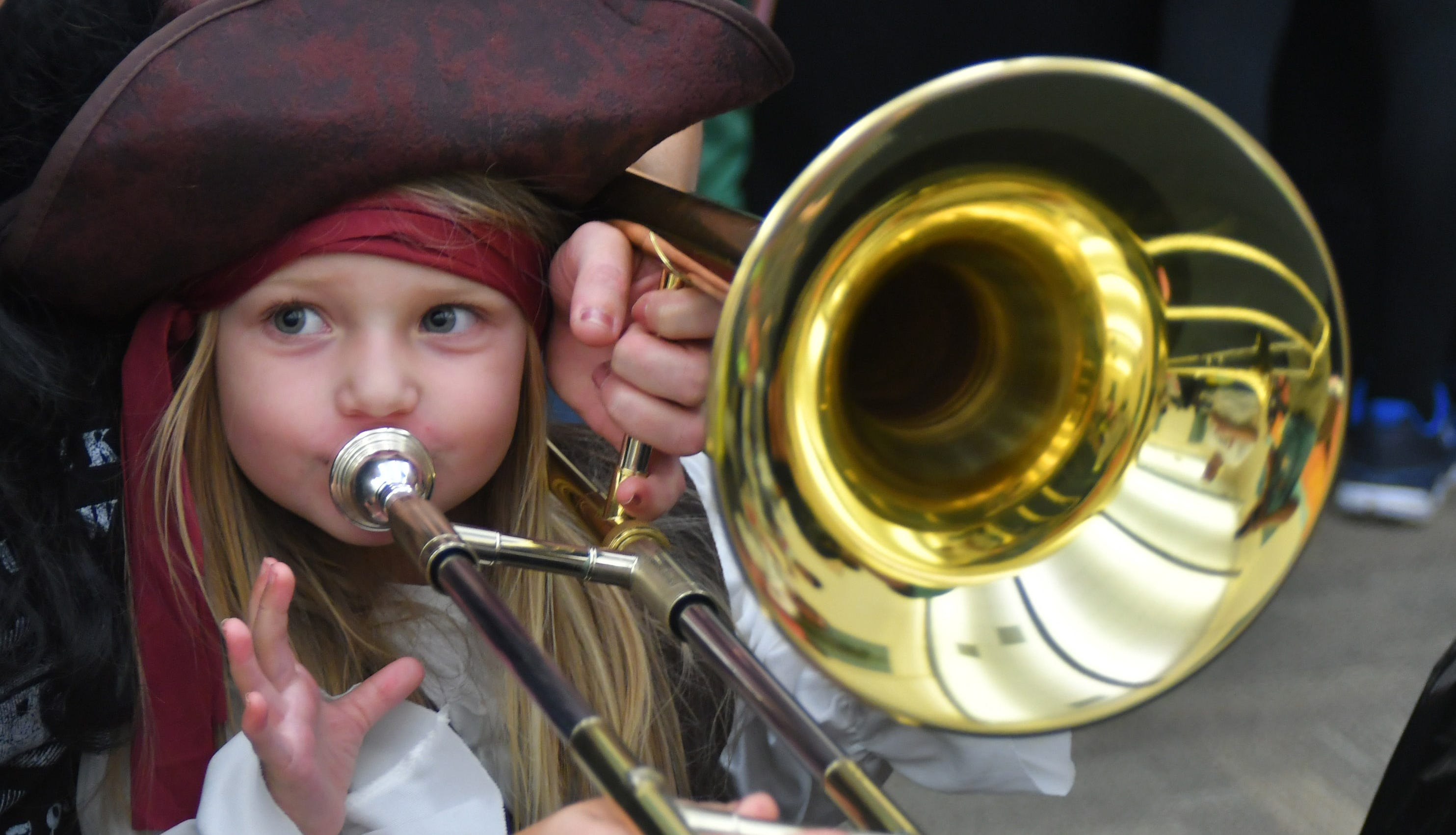 Carter Kestner, 3, tries out a trombone at last...