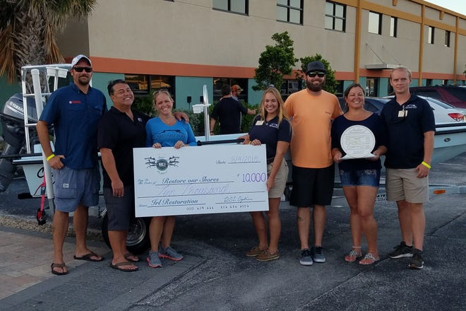 """Brevard Zoo receives $10,000 contribution for its """"Restore Our Shores"""" program from RCI Optics."""
