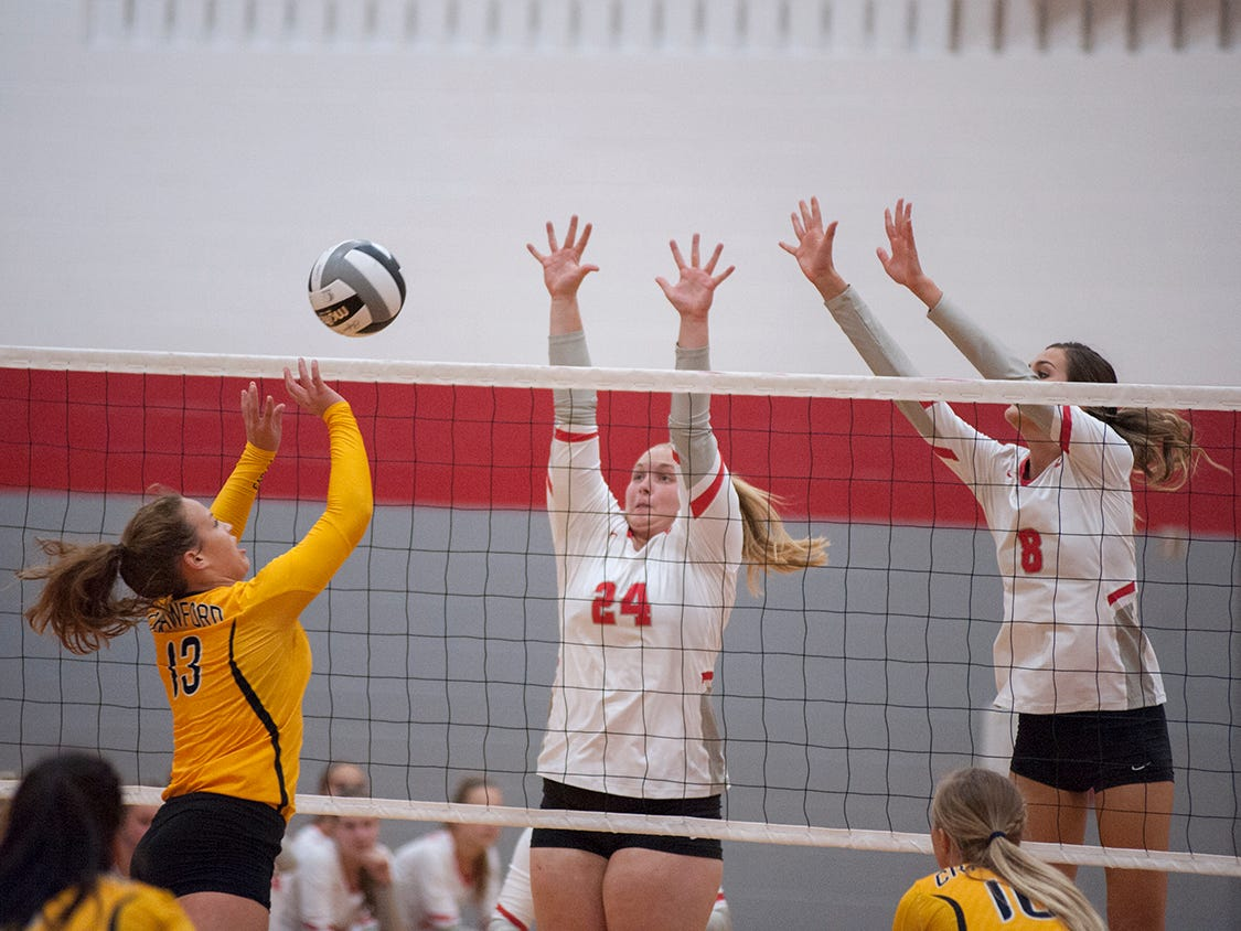 Buckeye Central's Courtney Pifher and Lexi Evak attempt to block a tip from Colonel Crawford's Allison Teglovic.