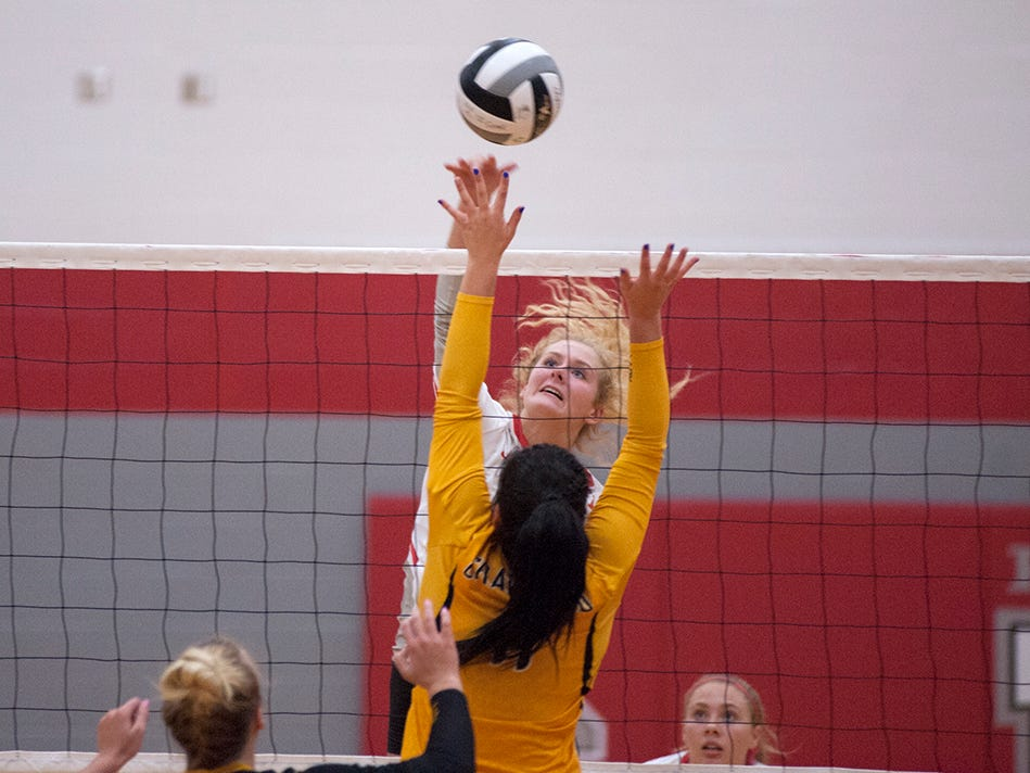 Buckeye Central's Alivia Niese hits a ball over Colonel Crawford's Izzie Stalter.