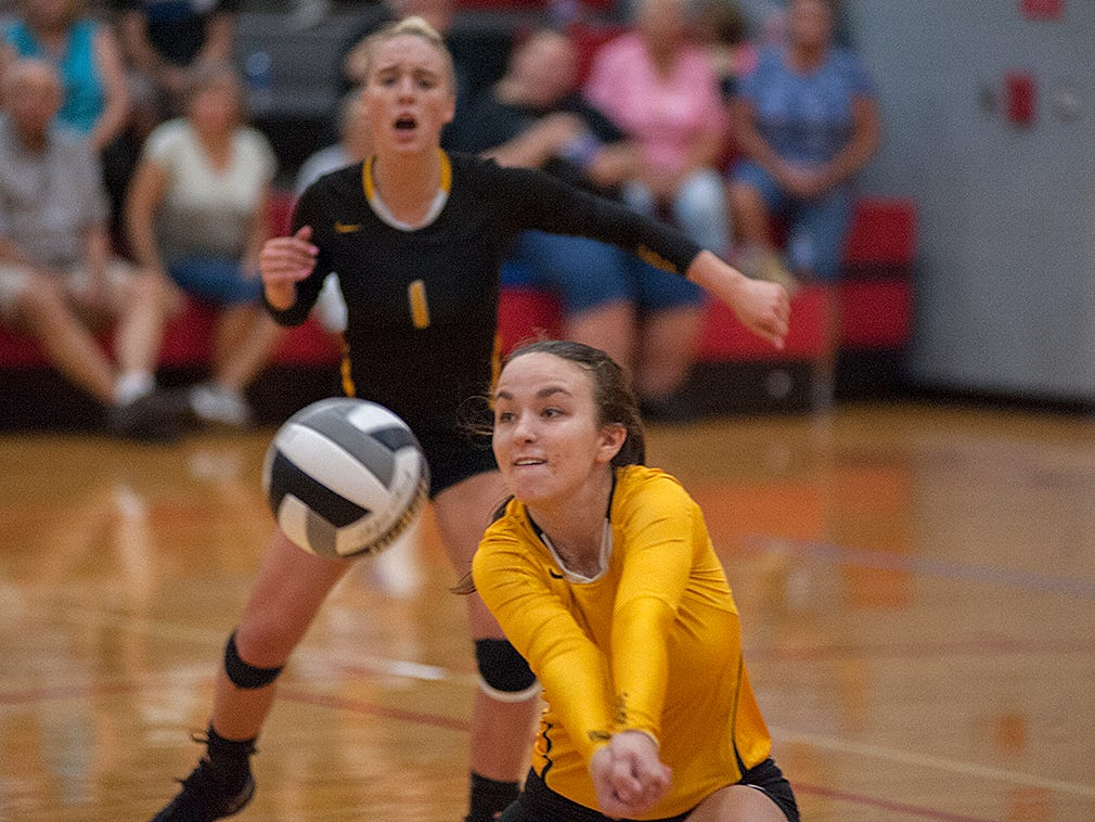 Colonel Crawford's Jenna Maddy receives a serve.