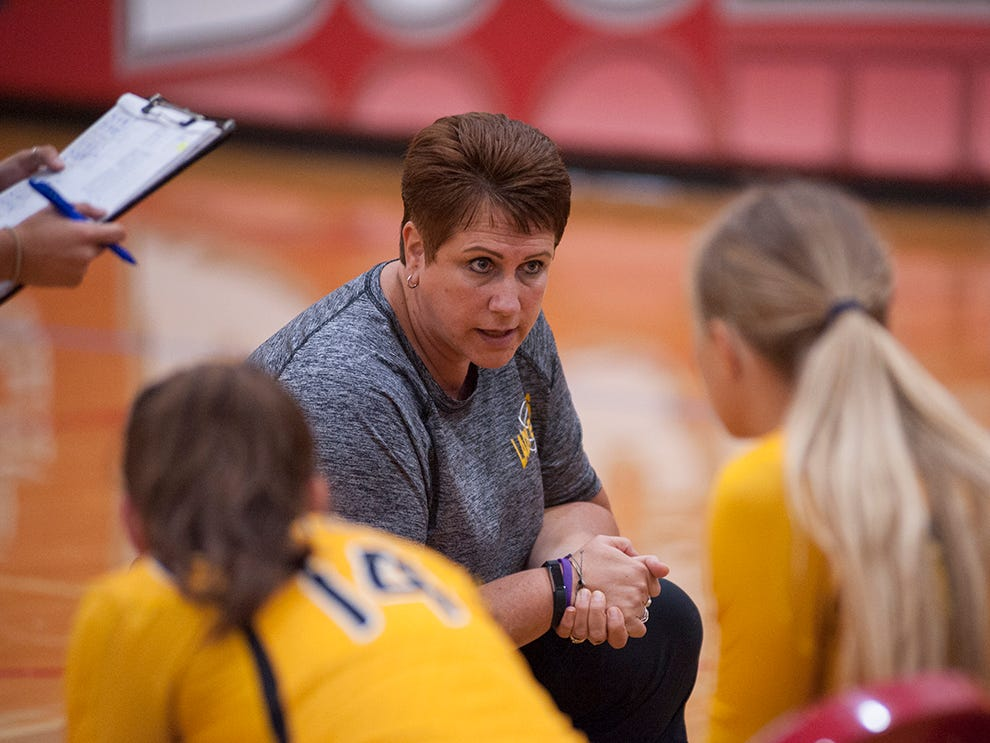 Colonel Crawford coach Amber Christy talks with her team during a timeout.