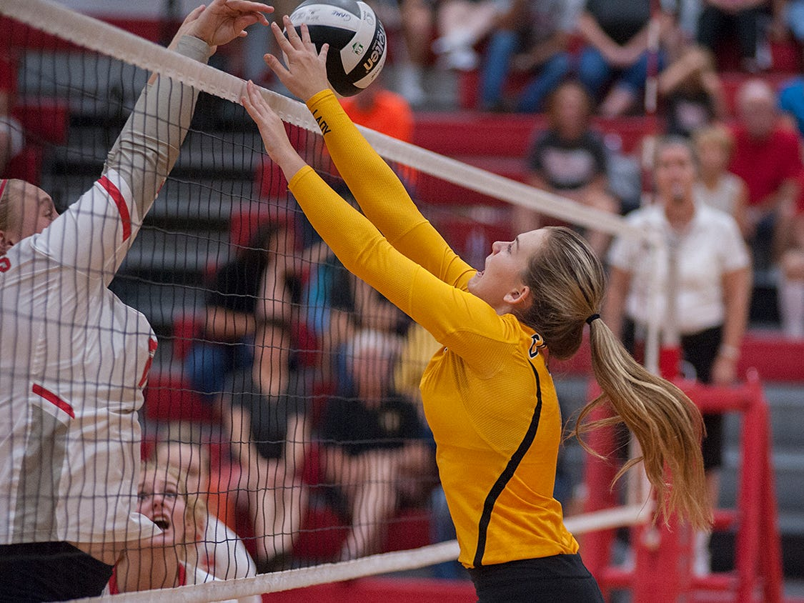 Colonel Crawford's Jenna Maddy attempts to block a tip from Buckeye Central's Courtney Pifher.