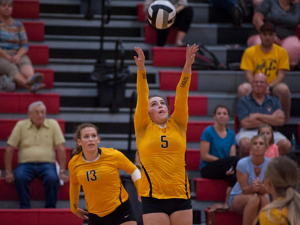 Colonel Crawford's Danielle Horsley sets a teammate.