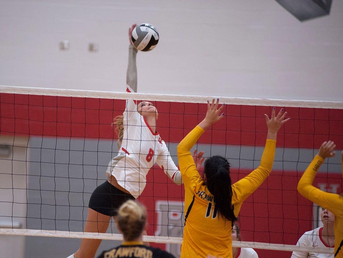 Buckeye Central's Lexi Evak spikes a ball at the net.