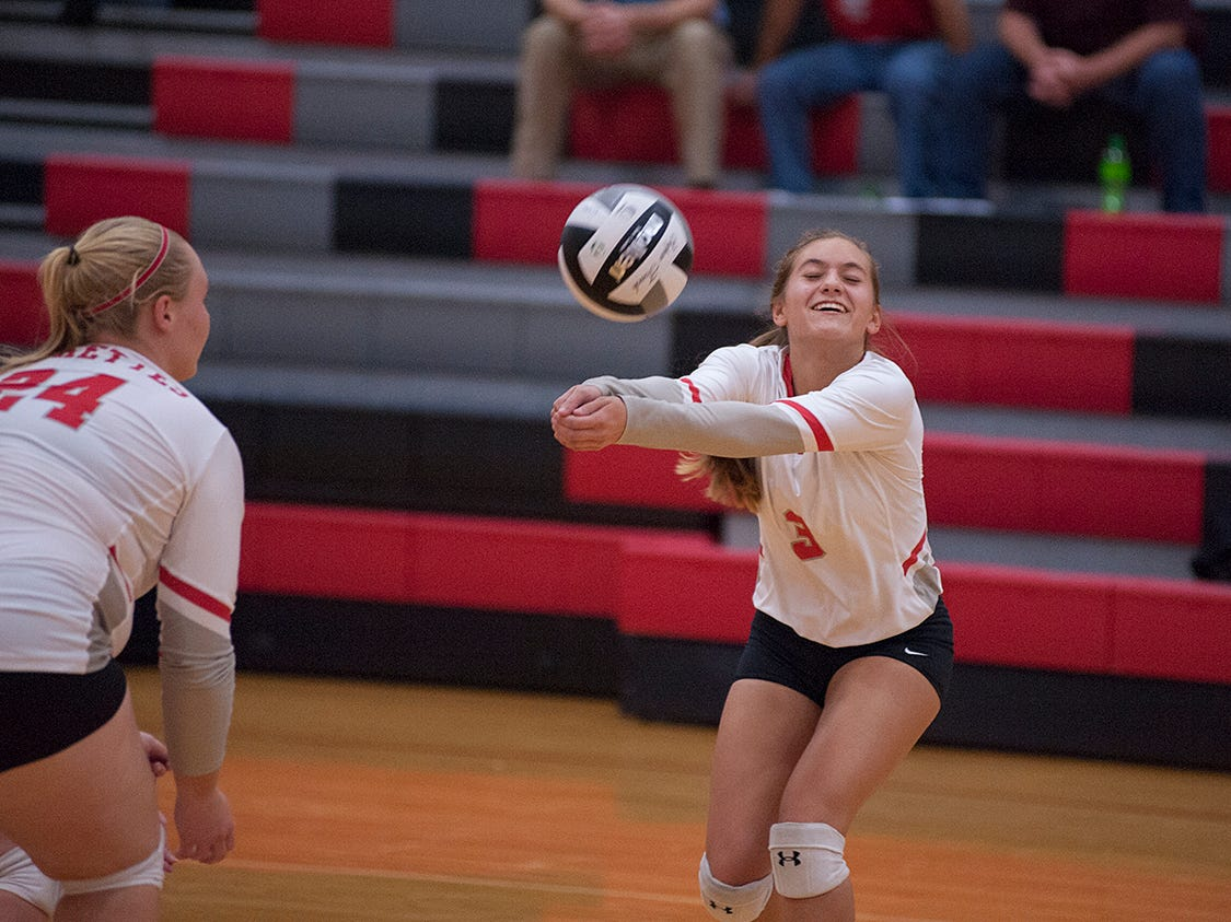 Buckeye Central's Kendra Ackerman digs a ball.