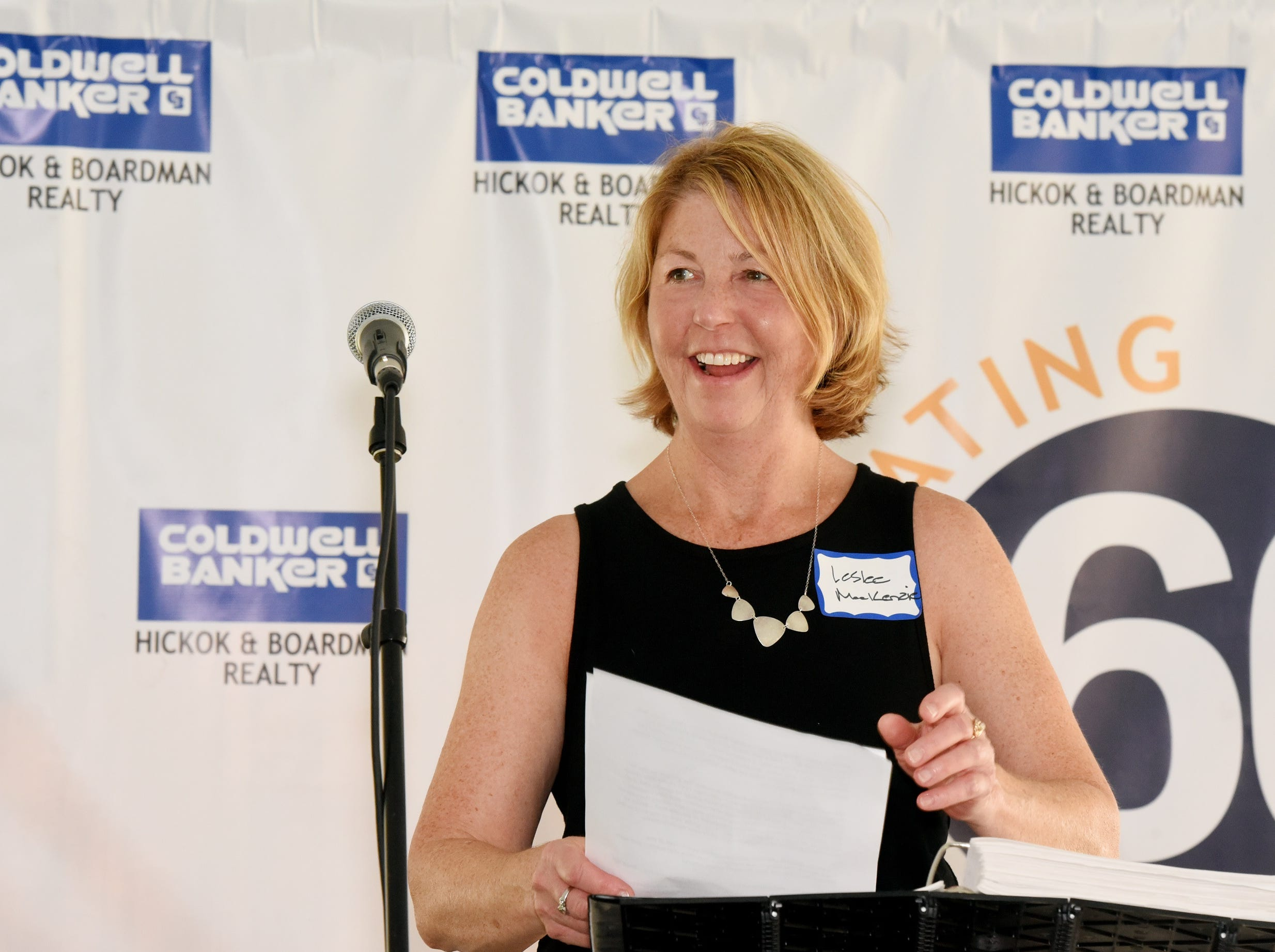 Leslee MacKenzie, President/Owner of Coldwell Banker Hickok & Boardman Realty speaks at the Coldwell Banker Hickok & Boardman 60th Anniversary on September 13, 2018, with current and past agents and community leaders in Burlington, VT.