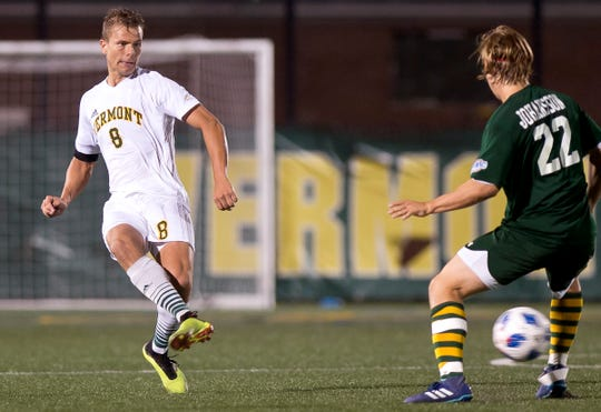 Vermont's Arnar Steinn Hansson, left, tries to pass through the Siena defense during Tuesday night's men's soccer game at Virtue Field.