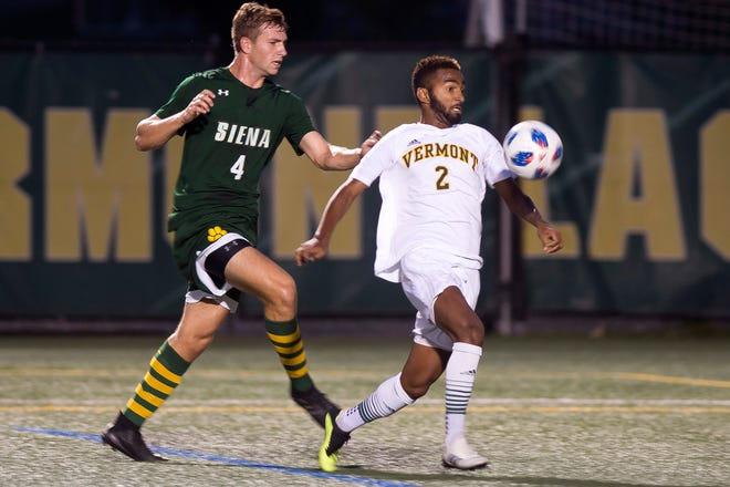 Vermont's Geo Alves, right, settles a pass in the box before scoring the only goal against Siena during Tuesday night's men's soccer game at Virtue Field.