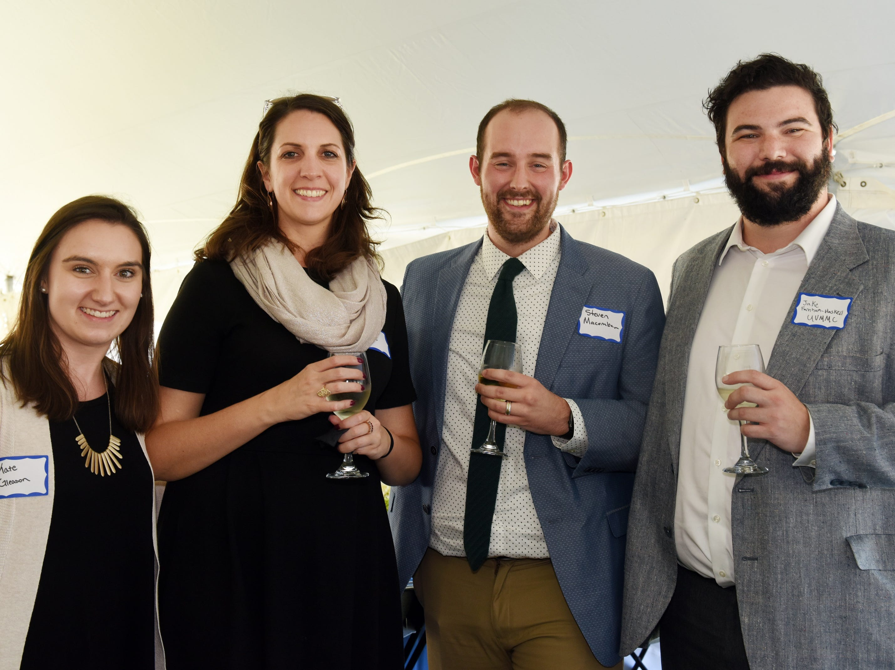 Kate Gleason of CBHB, from left, Meghan Brunovksy, Steven Macomber, and Jake Farnham-Haskell of UVM Medical Center Hospital attend the Coldwell Banker Hickok & Boardman 60th Anniversary on September 13, 2018, with current and past agents and community leaders in Burlington, VT.