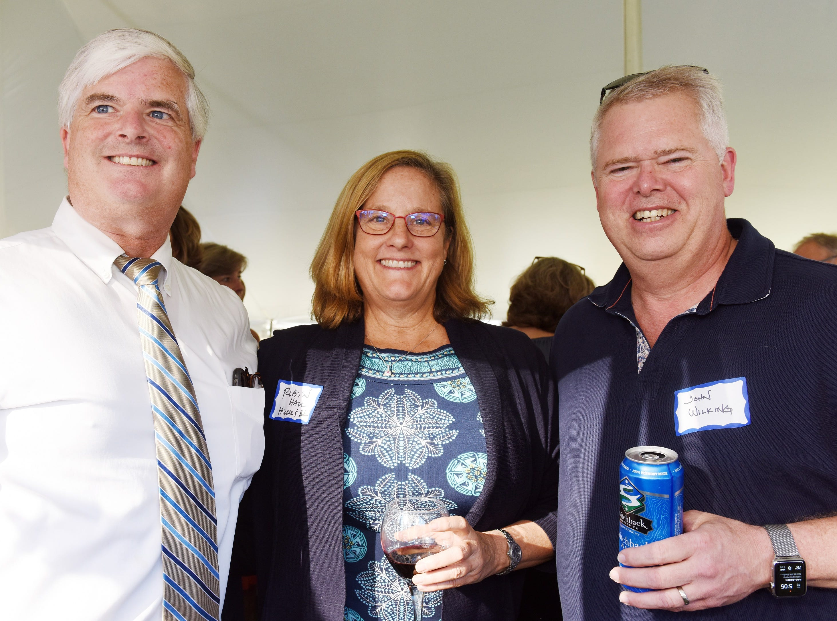 Dan O'Rourke, Robin Hall, and John Wilkings attend the Coldwell Banker Hickok & Boardman 60th Anniversary on September 13, 2018, with current and past agents and community leaders in Burlington, VT.