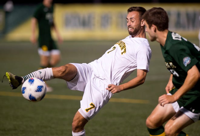 Vermont's Justin Freitas (7) tries to settle a ball out of the air against Siena during Tuesday night's men's soccer game at Virtue Field.