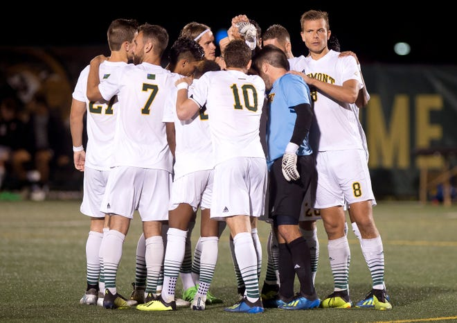 The University of Vermont men's soccer team huddles at halftime against Siena during Tuesday night's men's soccer game at Virtue Field.