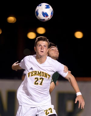 Vermont's Jon Bryant eyes a loose ball against Siena during Tuesday night's men's soccer game at Virtue Field.
