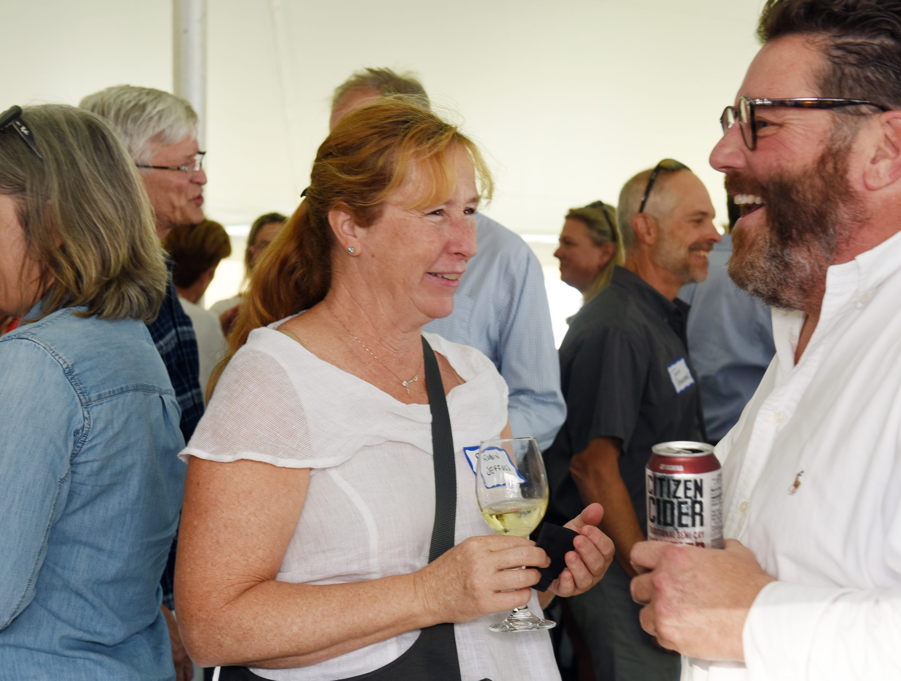 Robin Jeffers of SDI Ireland and Chris Senesac of C&M Custom Homes attend the Coldwell Banker Hickok & Boardman 60th Anniversary on September 13, 2018, with current and past agents and community leaders in Burlington, VT.