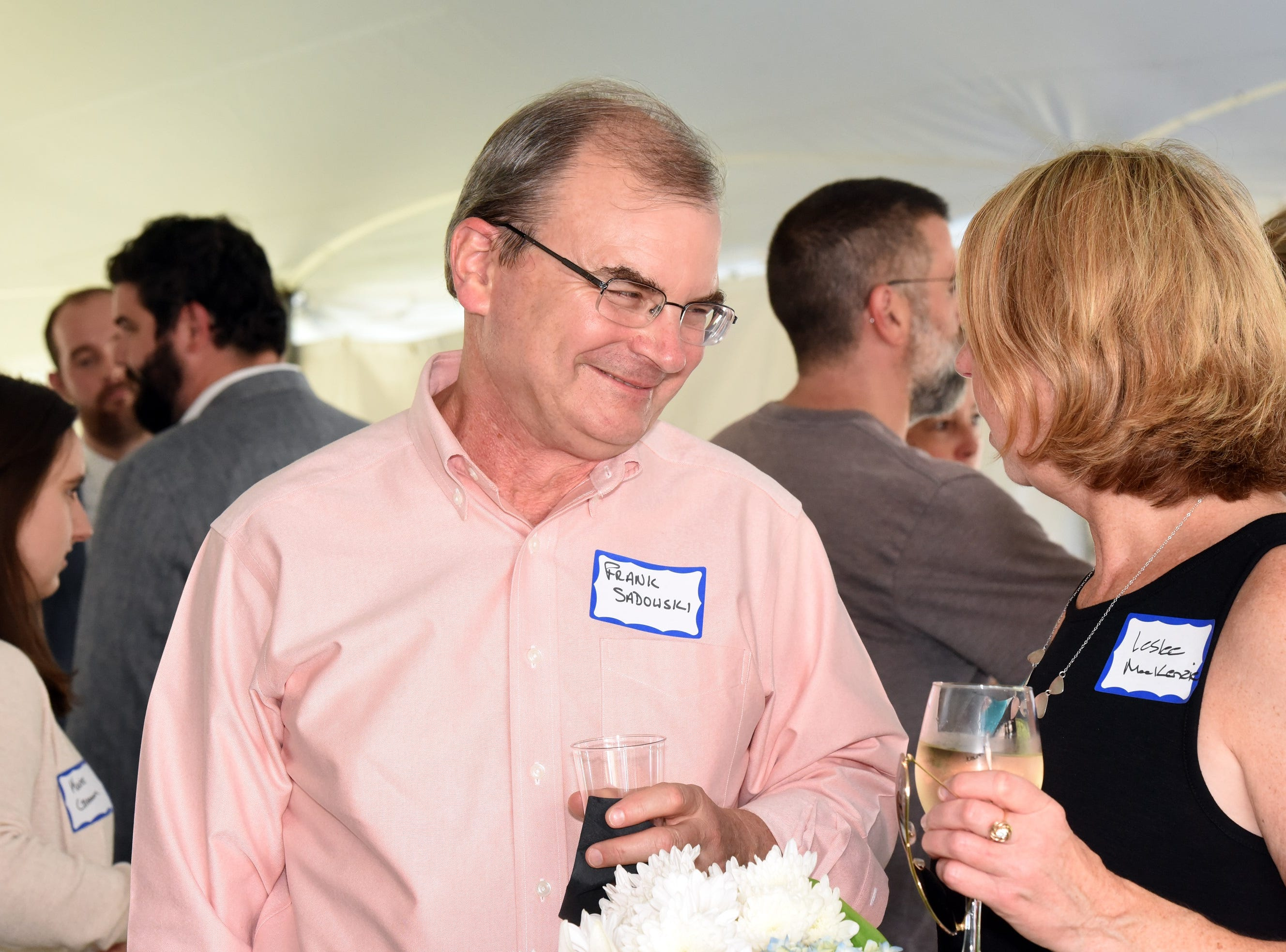 Frank Sadowski of Gallagher Flynn chats with Leslee MacKenzie as they attend the Coldwell Banker Hickok & Boardman 60th Anniversary on September 13, 2018, with current and past agents and community leaders in Burlington, VT.