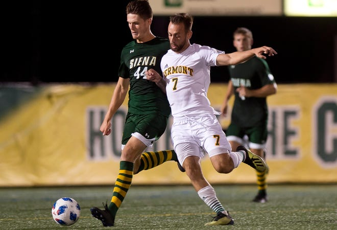 Vermont's Justin Freitas, right, tries to win the ball off of Siena's Kent Mohlar during Tuesday night's men's soccer game at Virtue Field.