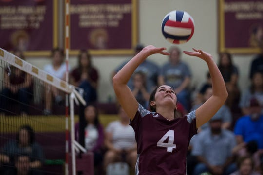 Flour Bluff's Cali Nims sets the ball against Tuloso-Midway during their volleyball game on Tuesday, Sept. 18, 2018 at Tuloso-Midway High School.