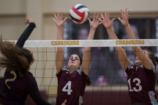 Tuloso-Midway's Jordyn Torre attempts to spike the ball past Flour Bluff's Cali Nims (center) and Gloria Geurin during their volleyball game on Tuesday, Sept. 18, 2018 at Tuloso-Midway High School.