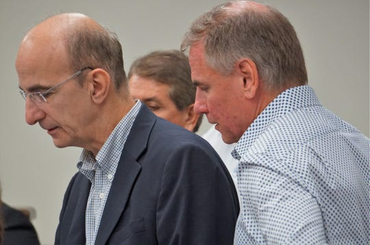 From left are Theodore N. Snyder, with Logistical Energy Management, and William Smith, president of Wilcox Oil & Gas Inc. as they give a presentation to Nueces County commissioners on Sept. 19, 2018.  Residents in northwest Nueces County are concerned with Wilcox's plans to drill for oil at a park near their homes.