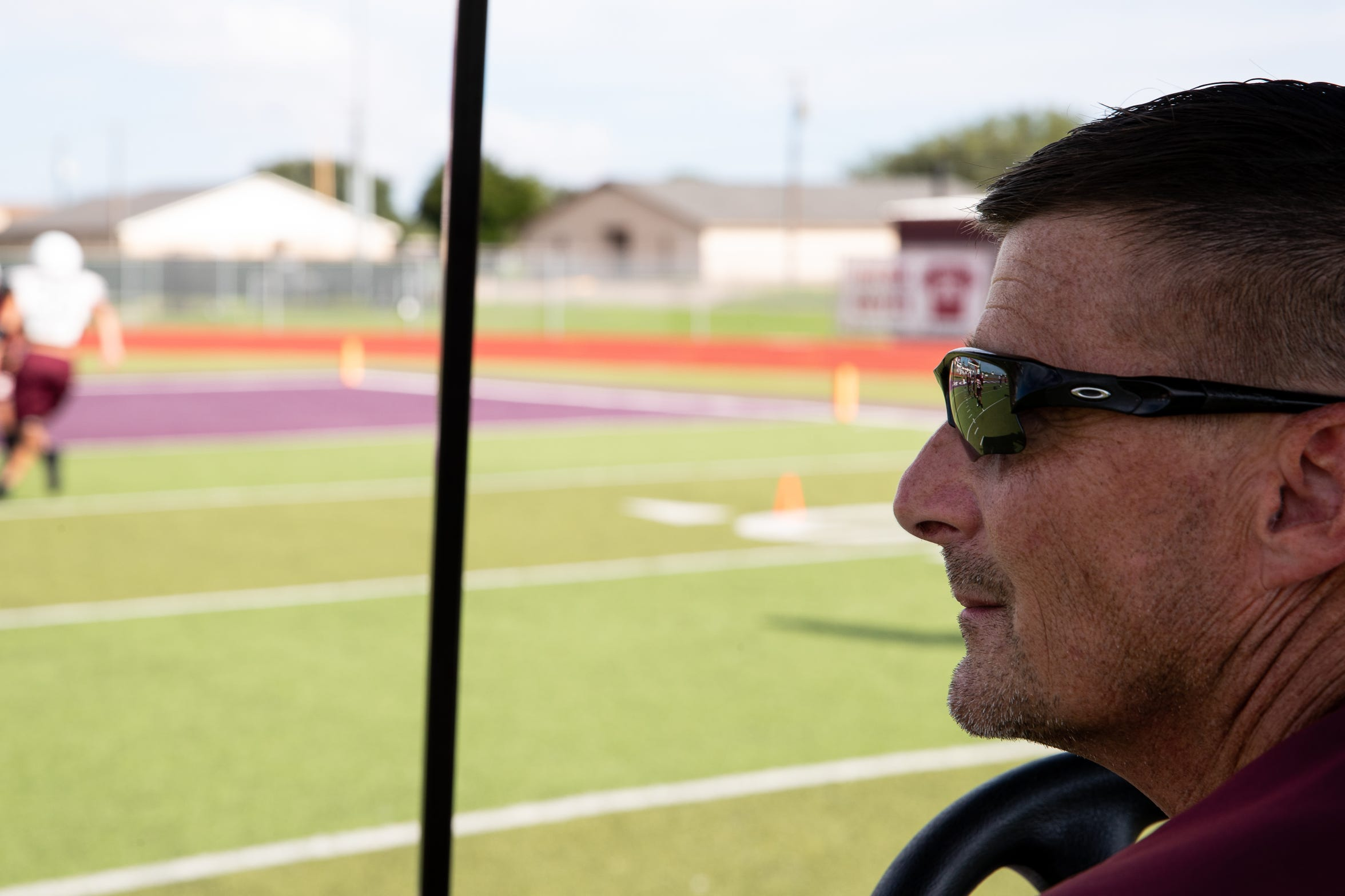 Tom Allen head coach of the Sinton football team watches from his cart as the team runs drills on the field during practice at Sinton High School on Tuesday, Sept. 18, 2018. Allen is suffering from a rare neurological disease that has him in a cart during games and practices