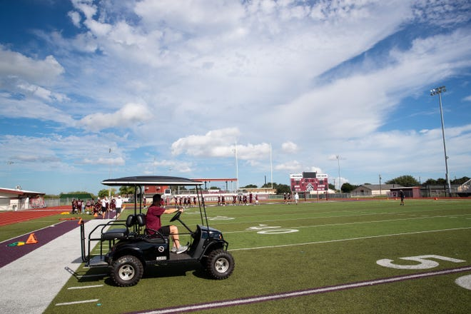Tom Allen head coach of the Sinton football team drives a cart across the field during practice at Sinton High School on Tuesday, Sept. 18, 2018. Allen is suffering from a rare neurological disease that has him in a cart during games and practices