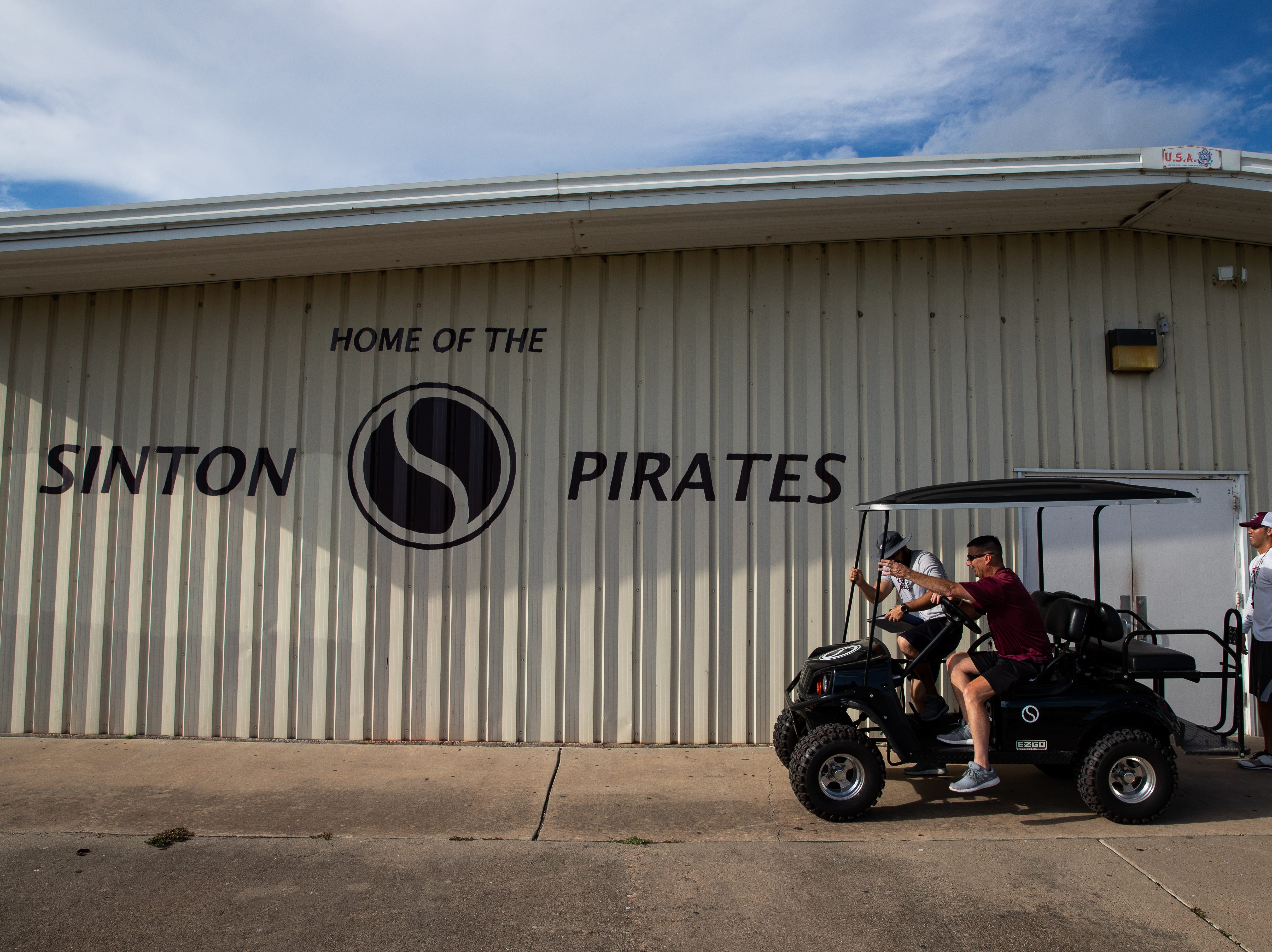Tom Allen head coach of the Sinton football team and his assistant coaches pull up to the teams field house during practice at Sinton High School on Tuesday, Sept. 18, 2018. Allen is suffering from a rare neurological disease that has him in a cart during games and practices