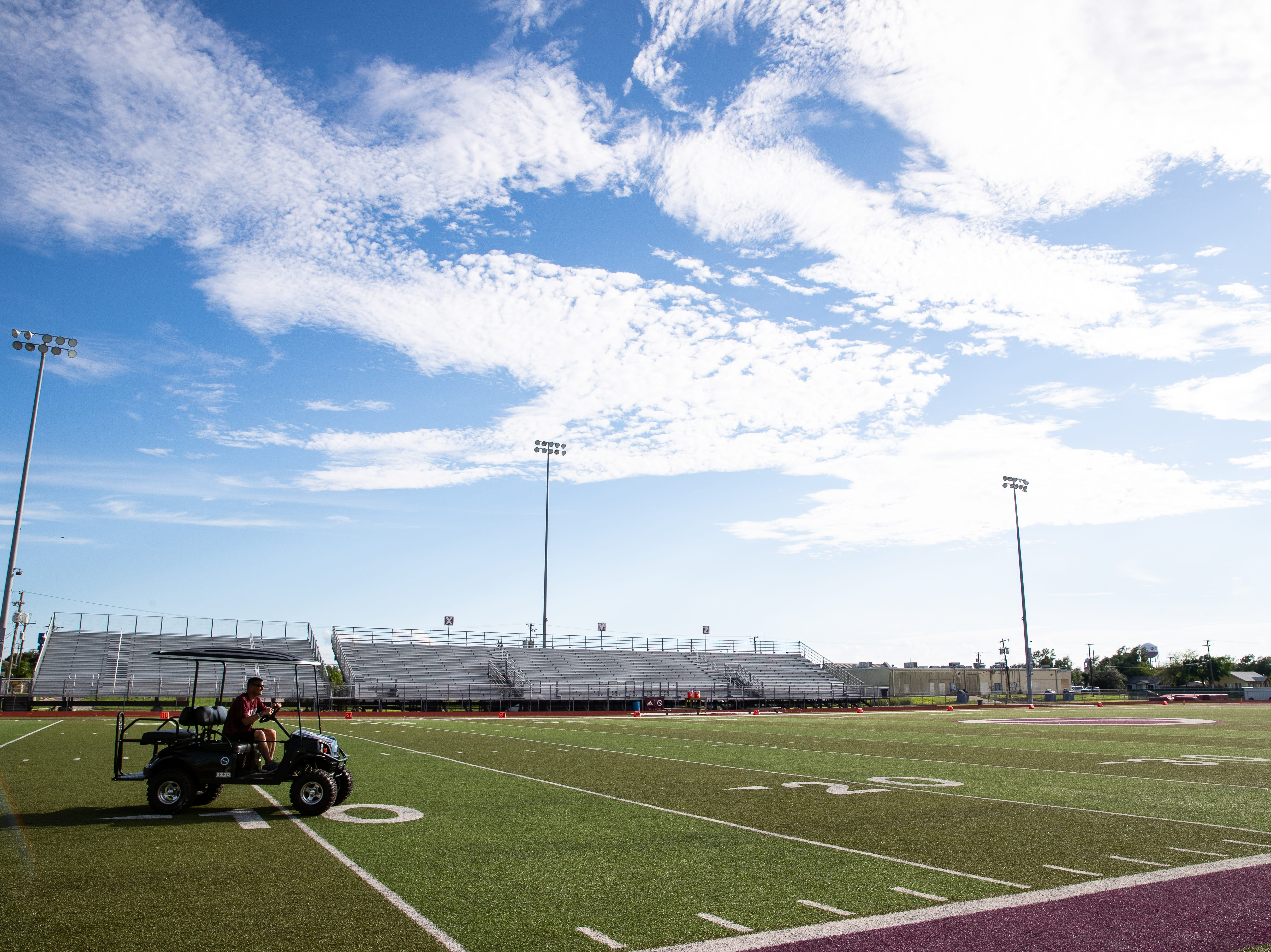 Tom Allen head coach of the Sinton football drives his cart across the field after his players leave at the end of practice at Sinton High School on Tuesday, Sept. 18, 2018. Allen is suffering from a rare neurological disease that has him in a cart during games and practices