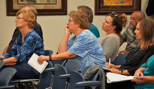 Residents who leave near Lone Oak Park in northwest Nueces County listen to a presentation from representatives with Logistical Energy Management and Wilcox Oil & Gas Inc. on Sept. 19, 2018. The residents later expressed concern with Wilcox's plans to drill for oil at the park, which is near their homes.