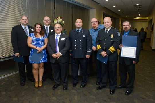 Virtua celebrated the survival of people who suffered cardiac arrest last year, during a dinner for survivors and their first responders at the Adventure Aquarium in Camden Sept. 13. From left: Joe Zuber of Mount Laurel EMS; Jessika Foy, bystander; Joe Brunges of Mount Laurel EMS; survivor Anthony Sapienza of Washington Township; Michael Denelsbeck of Mount Laurel Fire Dept.; Edward Carey, Virtua Paramedic; Joe Stringfellow of Mount Laurel Fire Dept.; and Michael Beringer, Virtua paramedic.