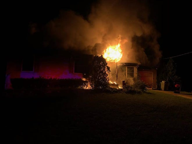 A firefighter was treated for minor burns after a Tuesday night house fire on Remington Avenue in Pennsauken.