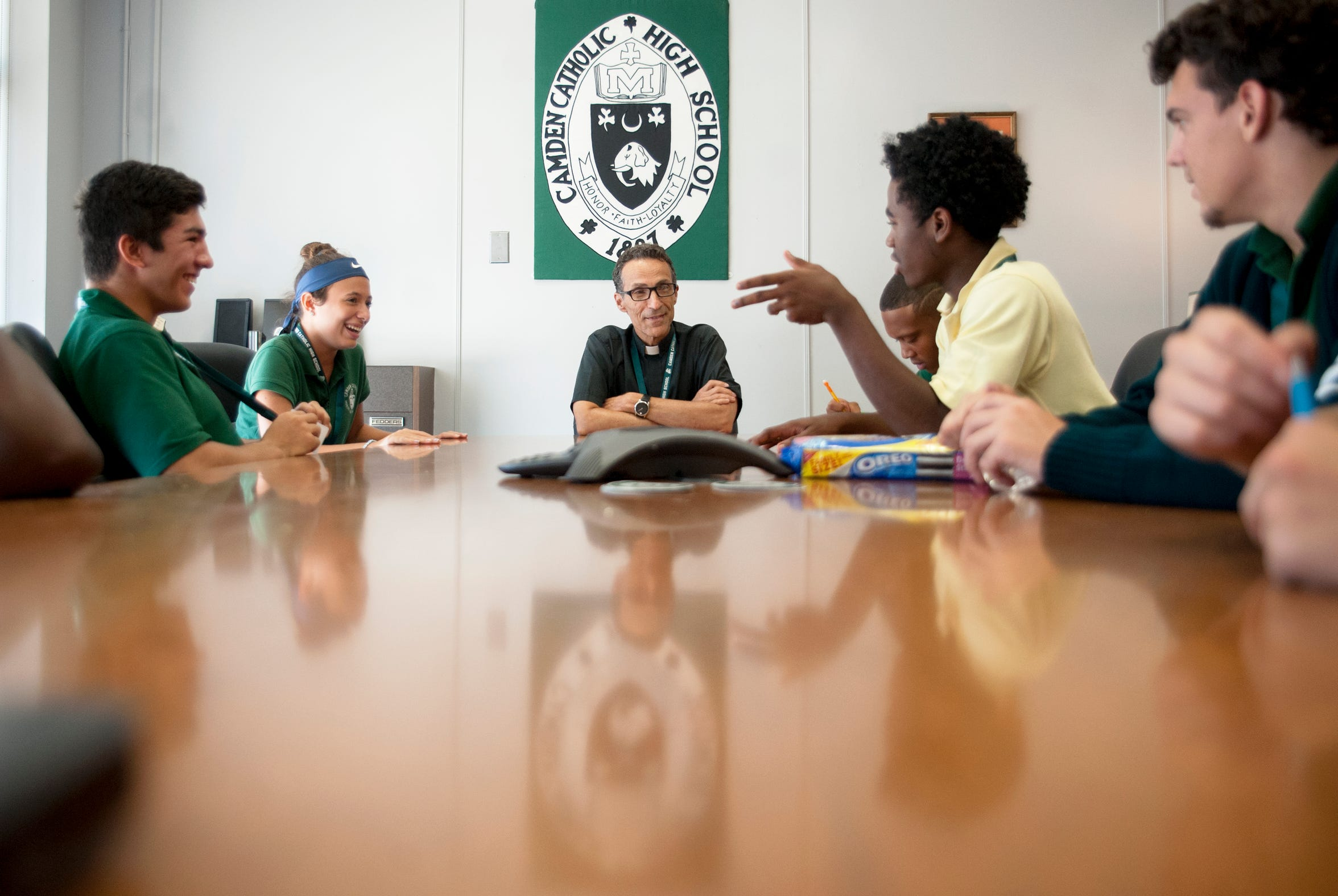 Father Joe Capella, center, rector at Camden Catholic High School in Cherry Hill, speaks with Camden Catholic students, from left, Harrison Hinojosa, Natalie Wisnoski, Cooper Grimes, George Lecato, and Brandon Mooney as the students visited Capalla in his office during their lunch period on Wednesday, September 19, 2018.