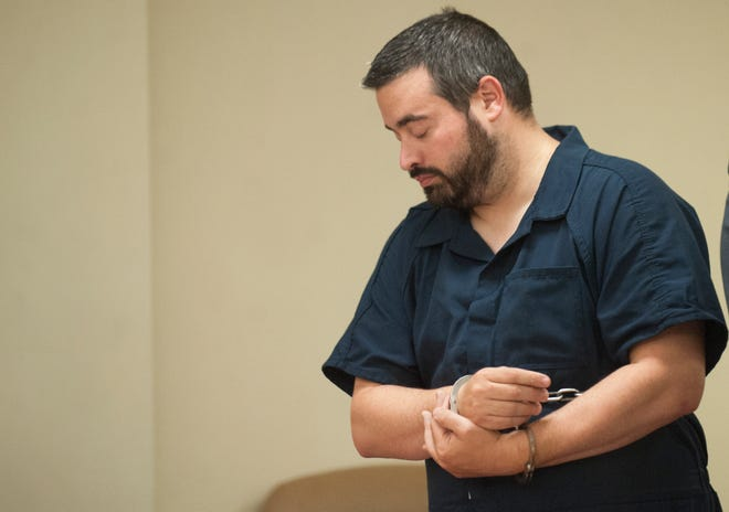 Jonathan Liano, a Berlin Township middle school teacher arrested after allegedly sending explicit messages and a photo of his genitals to an undercover detective posing online as a 14-year-old girl, and then bringing three condoms to an arranged meeting in a park, appears in court in the Camden County Hall of Justice on Wednesday, September 19, 2018.