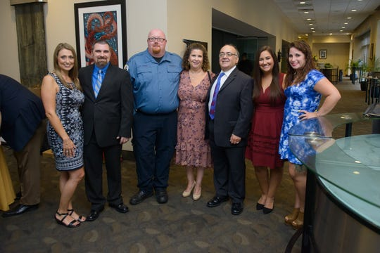 Virtua reunites cardiac arrest survivor, Anthony Sapienza of Washington Township, with his rescuers during a dinner at the Adventure Aquarium in Camden on Sept. 13.  From left: Amy Beringer, Virtua Paramedics Michael Beringer and Edward Carey, Kathy and Anthony Sapienza, their daughter Krystina Sapienza, and bystander Jessika Foy.  Sapienza traveled to Mexico for Krystina's wedding six days after his cardiac arrest.