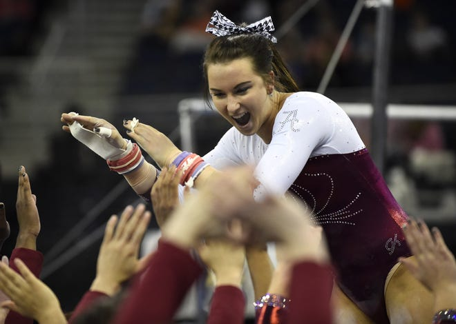 Alabama's Amanda Jetter reacts after performing on the uneven bars during the SEC gymnastics championships Saturday, March 21, 2015, in Duluth, Ga.