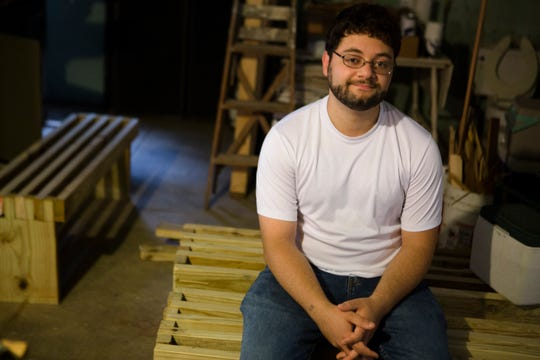 Mark Samaan, 24, sits on bus benches he creates for bus stops on Sept. 4, 2018 in Clifton.