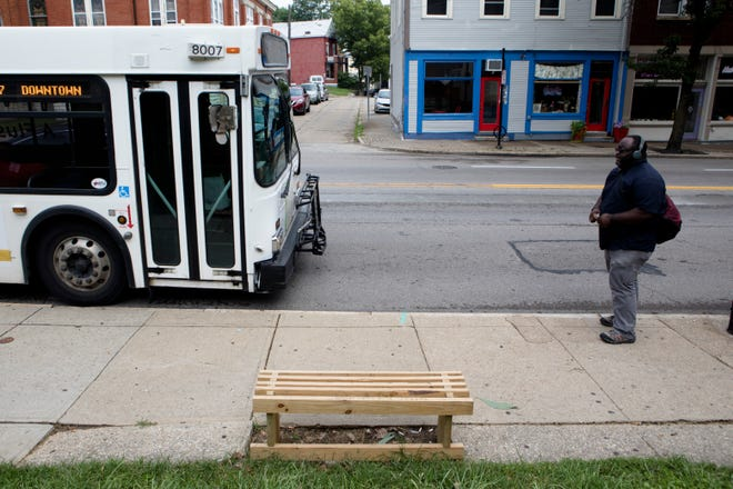 A bench built and placed by the Better Bus Coalition sits at a bus stop on Sept. 4, 2018.