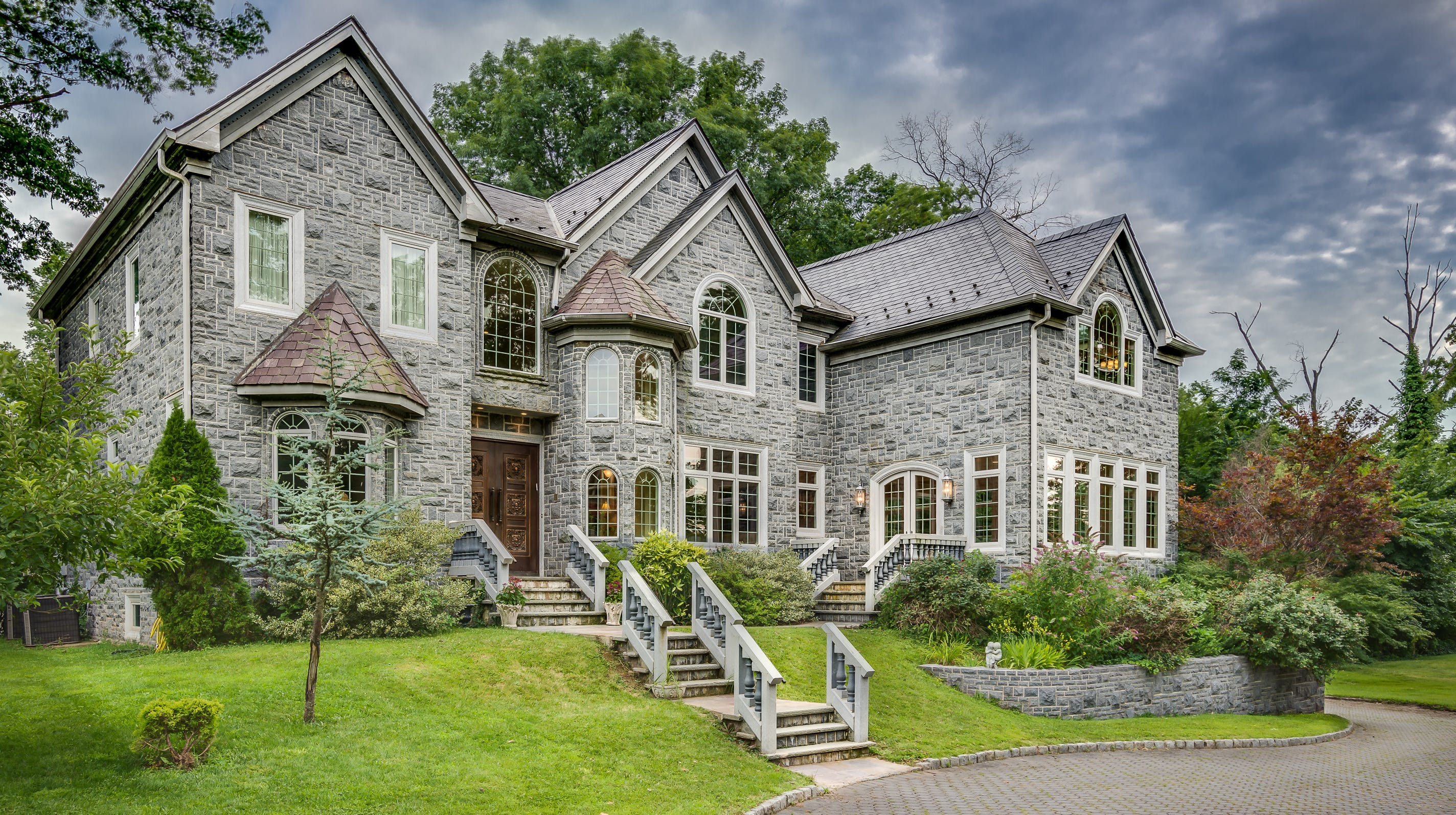 This five-bedroom estate home emulates a French chateau on more than an acre of secluded land in the Colonia estate section of Woodbridge.