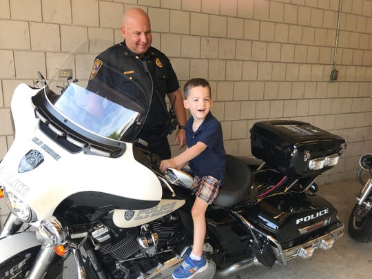 Joey Reinel, 3, visits with Old Bridge police Sgt. Bryan Doel who helped saved his life Aug. 19.