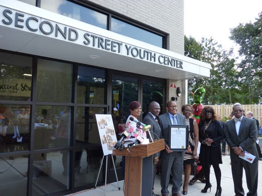 The Second Street Youth Center's board of trustees at the ribbon cutting of the center's new facility.