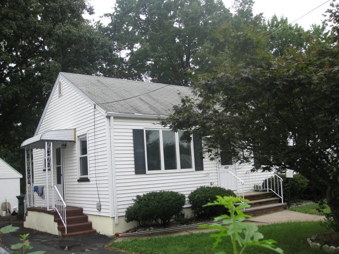 This two-bedroom ranch-style home in the Avenel section of Woodbridge has a partially finished basement and a detached garage/