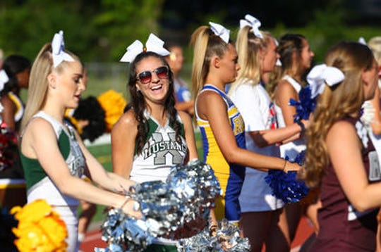 Cheerleaders from the Greater Middlesex Conference before the start of Snapple Bowl XXV at Woodbridge High School in July 2018.