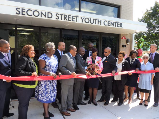 Plainfield Mayor Adrian Mapp and Second Street Youth Center Executive Director Leah Dade joined by a number of local and county officials, as well as developers, at the ribbon cutting of the new youth center.