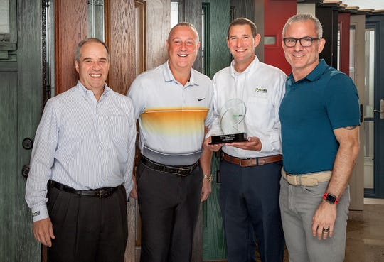 Bellari co-owners, President David Gropper, far right, and Executive Vice President Gary Shiman, second from left, are pictured accepting another Platinum Dealer award from ProVia at a recent ceremony in their Branchburg showroom. The occasion marked the company's final industry award under the Somerville Aluminum name. Presenting the award are Ken Young, ProVia's director of sales, Windows & Doors, Northeast Region, far left, and Account Manager Bob Rossi, second from right.