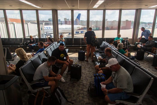 Passengers await a flight out of Des Moines International Airport Sept. 14, 2018.