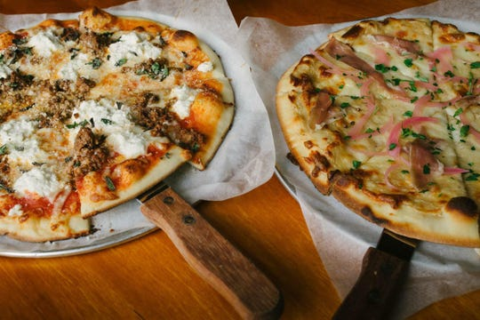 Handcrafted pizzas from Blue Tomato Kitchen.