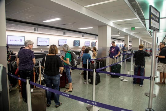Passengers check in at the Des Moines International Airport Sept. 14, 2018.