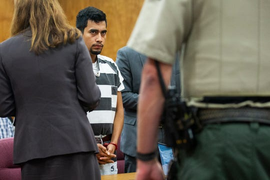Cristhian Bahena Rivera, 24, stands to leave the courtroom after pleading not guilty to the charge of first-degree murder in the death of Mollie Tibbetts, on Wednesday, Sept. 19, 2018, at the Poweshiek County Courthouse in Montezuma.