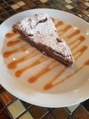 Flourless chocolate torte with salted caramel from Blue Tomato Kitchen.