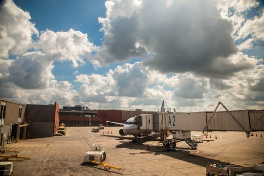 A plane waits at gate A2 at Des Moines International Airport Sept. 14, 2018.